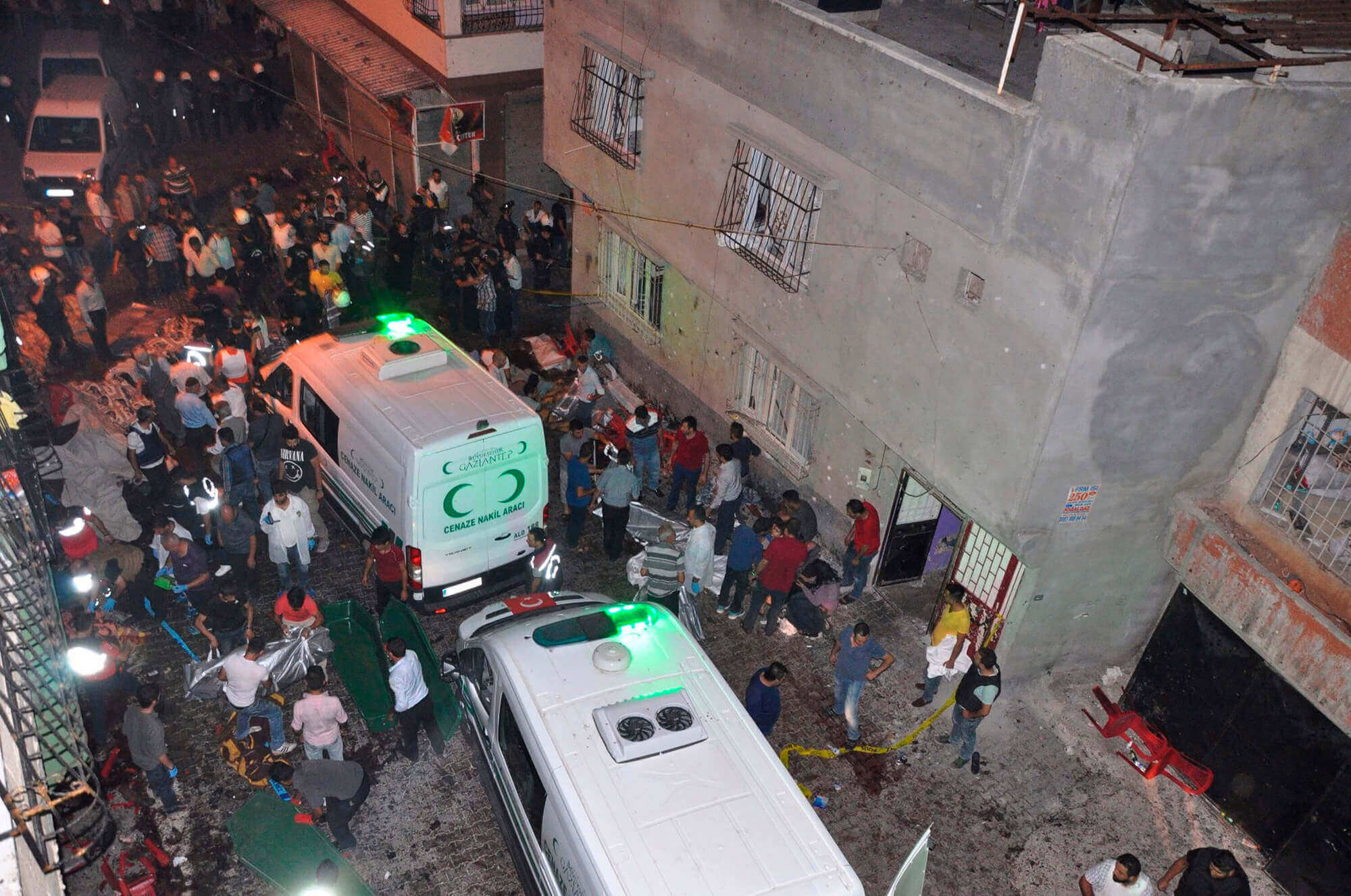 Image of people carrying dead bodies into ambulance after explosion at wedding in Turkey