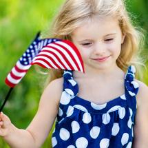 Girl waving American flag