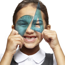 Smiling school girl with set square and protractor over her eyes