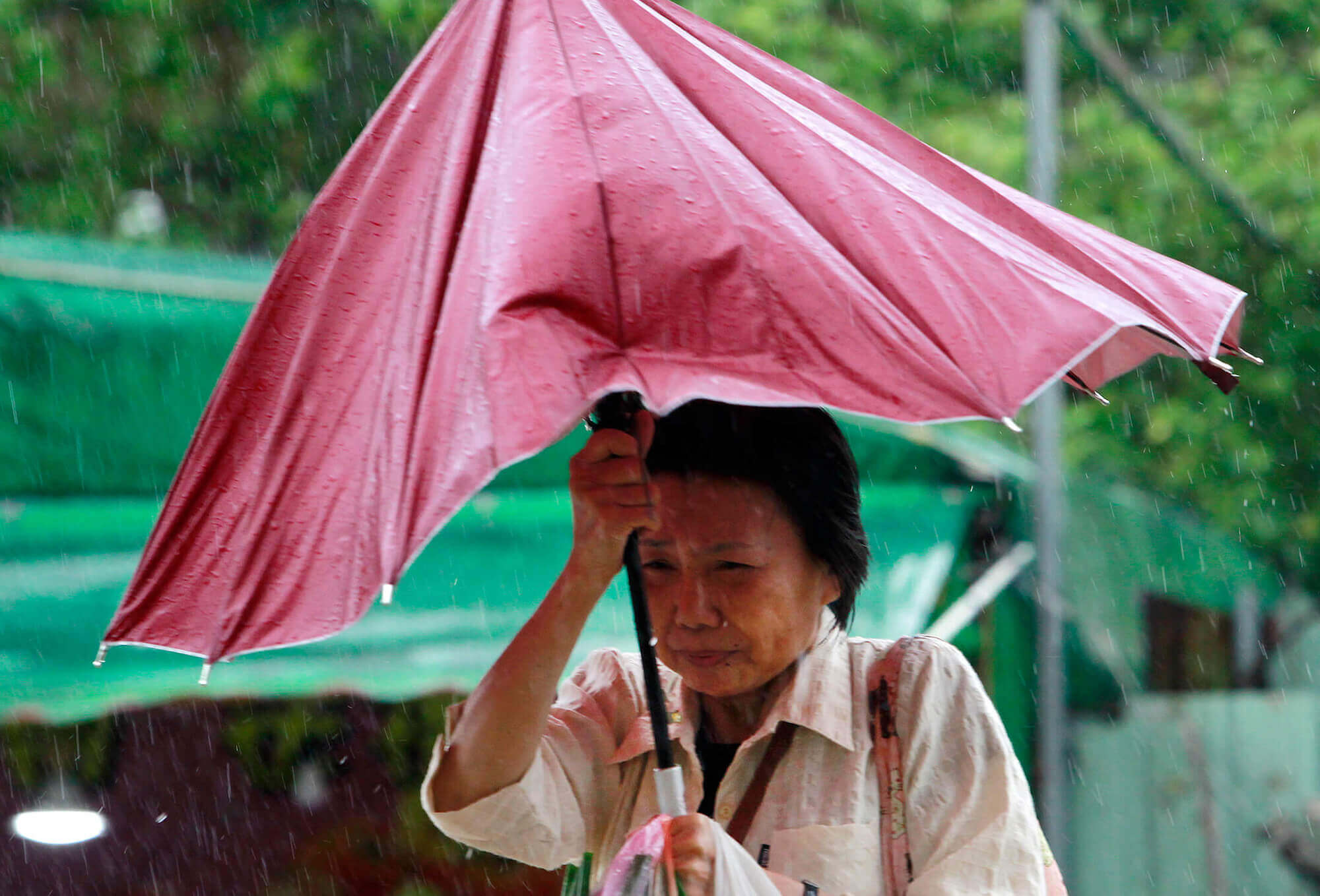 Image of woman in Taiwan with umbrella