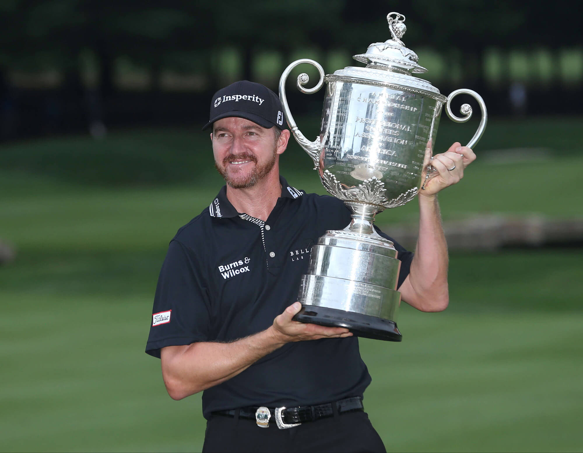 Image of Jimmy Walker with the trophy from PGA major.