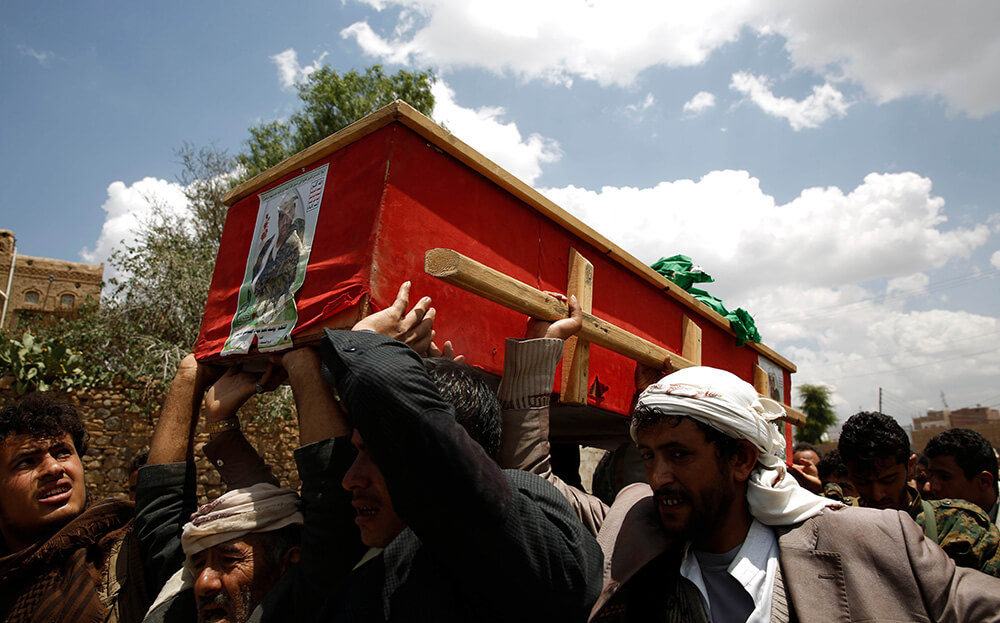 a fellow Houthi is laid to rest in Yemen